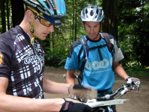 Brashears (l) and Klein (r) read the forest trail map.